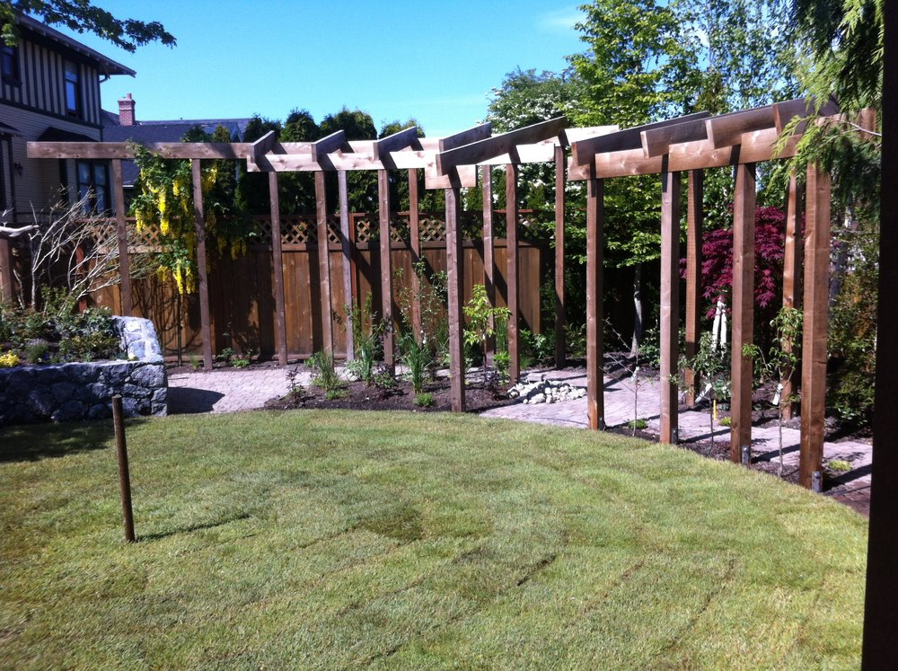 curved beam pergola for a secret garden