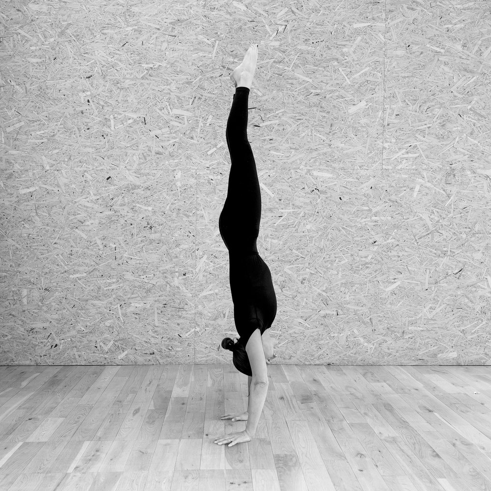 yoga handstand woman