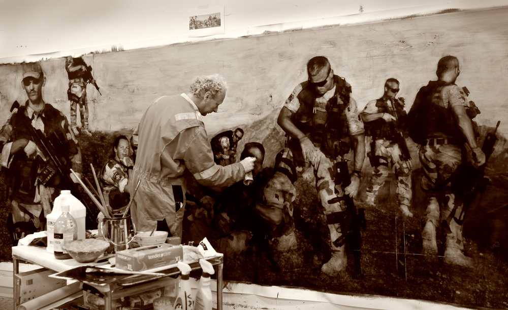 In the Artist Studio :  Per Fronth working the surface of  AFG ( Paraphrase The Storyteller)  / Mixed Media / Oil on canvas / 443 x 167 cm / 174 x 66 in/ in 2009.  The artwork is part of the series Theatre of War which saw Fronth go to worn torn Afghanistan to collect raw-material for his new focus, the Western worlds desire to exporting democracy to warlord countries in the east, a physical response to the 9/11 World Trade Center terror attacks in Per Fronths own neighbourhood in New York. The Norwegian Intelligence Service later acquired three works from the Theatre of War series.