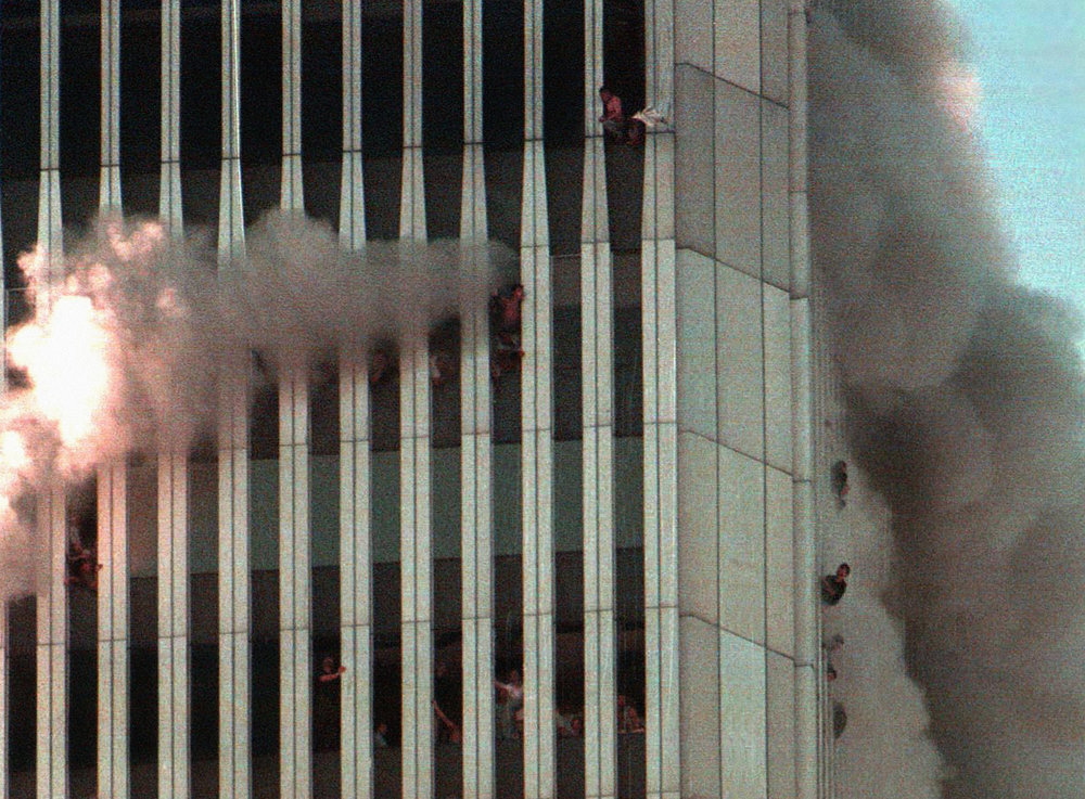 New York / Sep 11 2001:  This morning Per Fronth became an eyewitness to the largest and most spectacular act of terrorism the world has known.  Living in Tribeca in New York just a few blocks away from the WTC at the time Fronth photographed the horror. Here the North Tower seen some 20 minutes after the first plane hit.
