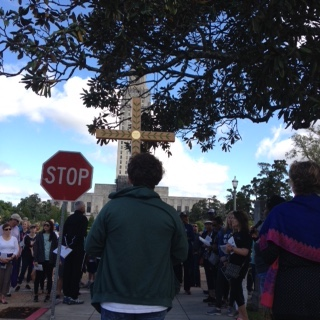 Pictured above is a view of the Way of the Cross with the Capital in the background as the twelfth station is being read.