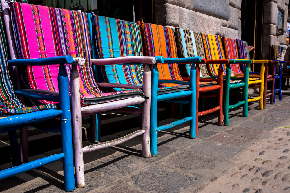Andean tapestries being used in chairs, Sacred Valley - Peru