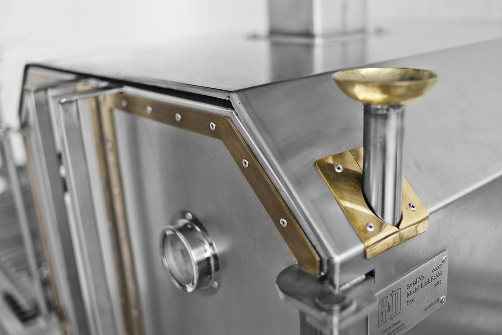 On all of our ovens we offer a steam function system where the steam is being released around the bottom sides and back. Hand hammered brass funnel to soften up the cool stainless steel look.