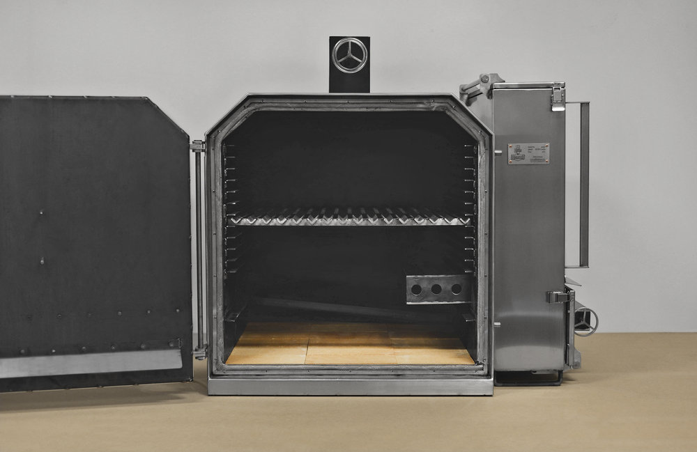 The oven/smoker has room for 12 height settings which are all slightly tilted back towards the grease collection which automatically empties on the outside of the oven. The bottom is made from ceramic fire bricks which makes it ideal for high heat cooking and baking.