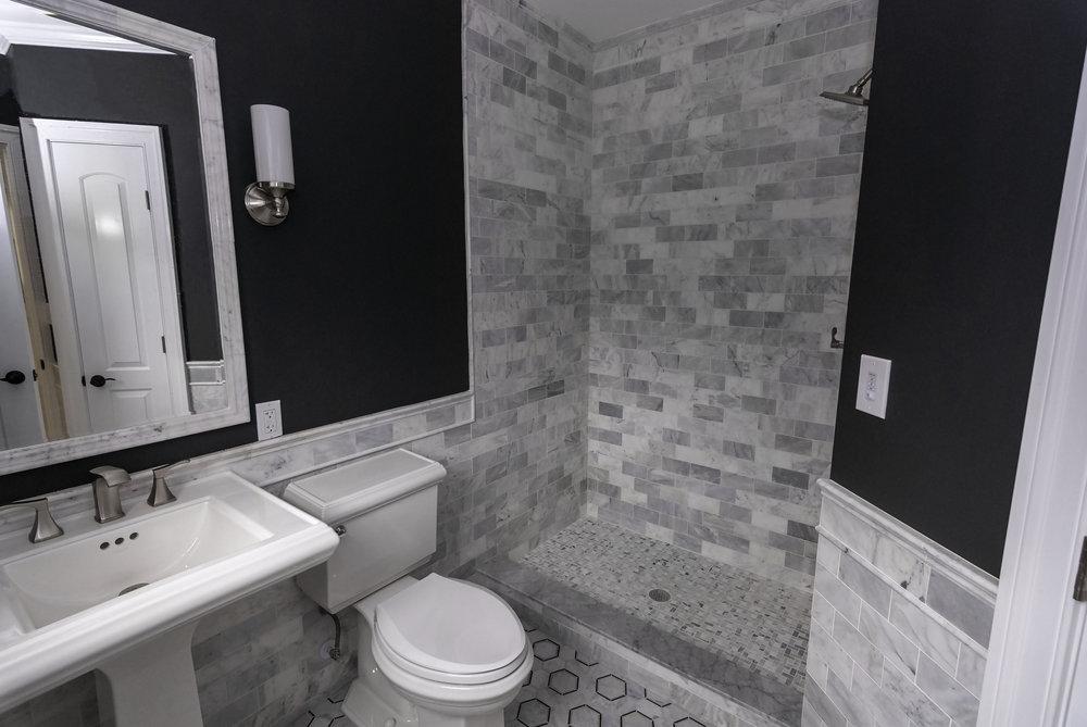 riverhouse 1st bathroom sink and shower.jpg