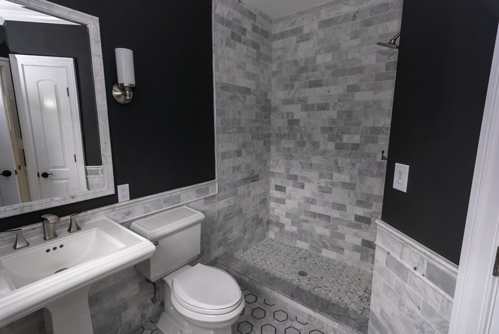 riverhouse 1st bathroom sink and shower.jpg