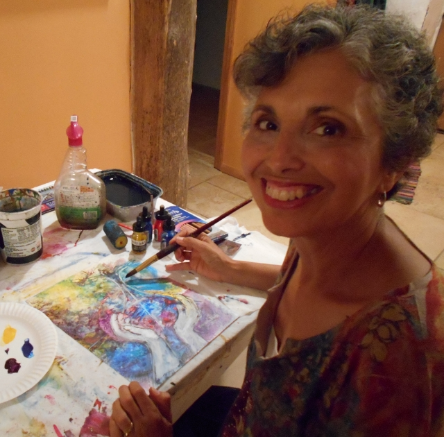 Deborah painting in her stawbale home and studio