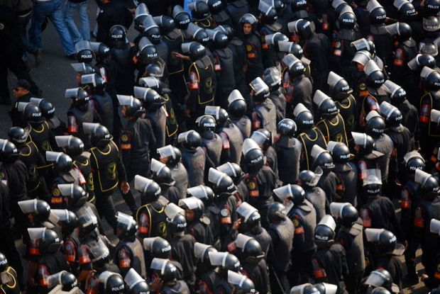 Image of Egyptian Security Forces surrounding a protest