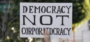 Democracy-Not-Corporatocracy-300x140.jpeg