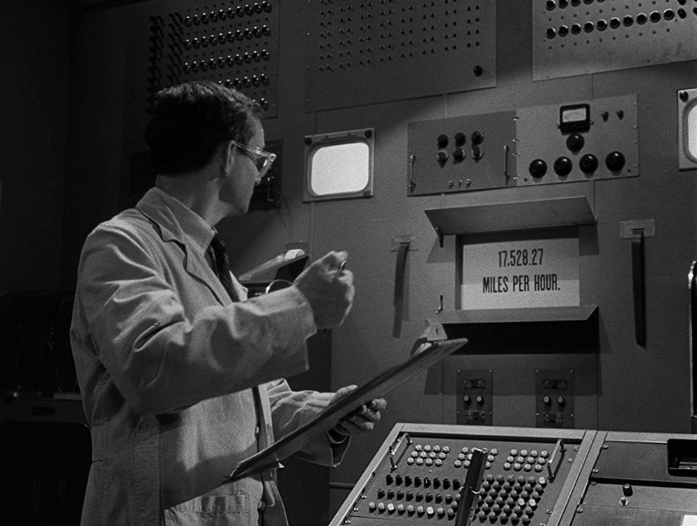 """Goofy scientist, James Elwood is the protagonist of this journey into the Twilight Zone. Mr. Elwood finds himself in charge of a very advanced machine named """"Agnes"""" that can compute answers to pretty much any question thrown its way. Sound familiar? It is then that Mr. Elwood falls victim to a very jealous Agnes that is sabotaging all of his chances with the girl of his dreams. This idea might sound familiar if you saw Spike Jonze's film """"Her"""", which owes a lot of credit to this revolutionary episode. Kubrick even touched on this concept of machines having their own personal motives in 2001, when the astronauts AI """"HAL"""" begins to control and off them because of it's own jealousy and motives. Rod Serling sums it up best when he closes the episode by saying: """"Machines are made by men for man's benefit and progress, but when man ceases to control the products of his ingenuity, he risks losing the benefit."""" All I gotta say is Siri better pump the brakes if she thinks about pulling a fast one on me."""
