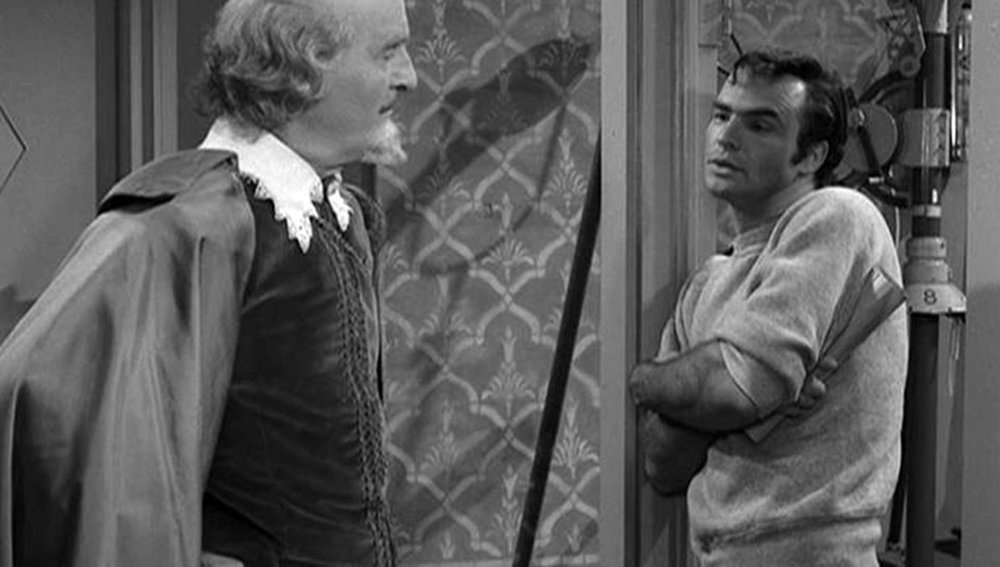 """This episode is a total dig at what Rod Serling believed and accurately predicted about the entertainment and television industry. Julius Moomer is a talentless screenwriter who finds luck after having William Shakespeare appear to him with the use of a little black magic. Moomer decides that Shakespeare is going to ghostwrite his newest project and he's going to present it. But, when Shakespeare pulls up the set and sees just how much they changed his work, he gets pretty pissed. Sure this episode is a little corny, but at its core it's depicting the very entertainment industry we latch ourselves onto daily. An industry where our most popular """"artists"""" can't even play instruments or sing without autotune is exactly what Rod depicted for us here. No matter how substance filled a project may be, if that's not what will grab the public's eye then it should be changed. Substance and aesthetic has been put away in exchange for arousal and attention and we see it just as much today as ever. I mean, in a world where Lil Tay is practically a household name, how can this episode NOT ring true?"""