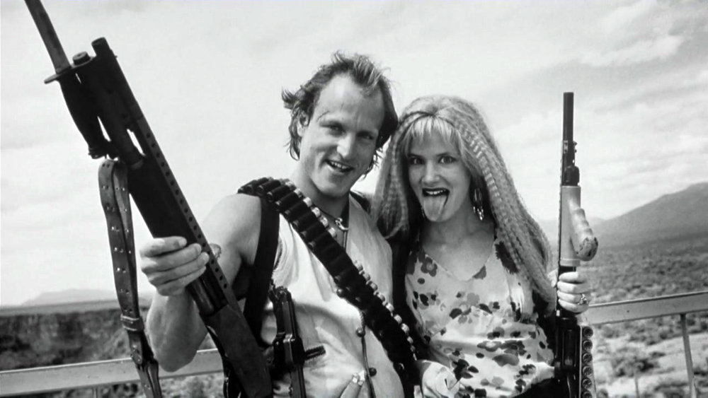 "Now if there was one project written/created by Tarantino that I wouldn't even necessarily have wanted him to direct it would be Natural Born Killers. (Not because I don't think he would've killed it, but because what we got is so unique I wouldn't want it any different.) Tarantino came up with this story about Mickey and Mallory Knox and how this serial killing couple became celebrities, which I must say is VERY ""Tarantino"". But, when he passed it on to Oliver Stone to direct, I think that was for the best. What Oliver Stone gave us is one of the most unique films to ever grace the cinematic screen. From scenes in black and white to colorfully, psychedelic scenes to a scene that is acted out like a 50's sitcom, this film is as reckless and unpredictable as Mickey and Mallory. Now, I don't know how much of any of those ideas came from Tarantino himself, but if they didn't then I'm sure as hell glad Oliver Stone got to direct it and give us the Natural Born Killers we got to see. It's important to note, however, that without Tarantino's writing and general idea, these crazy and trippy visuals wouldn't have worked as organically as they did. It would have just been like any rap video with trippy effects for no reason at all."