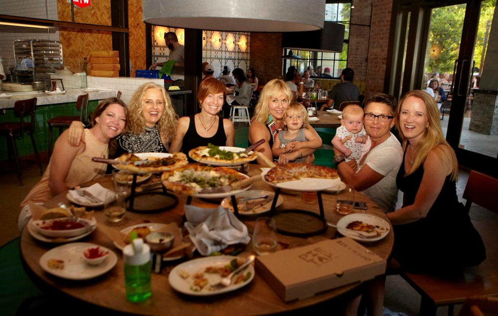 a bunch of yoga teachers eatin pizza. Photo by Doug Davis.  d2studios.net