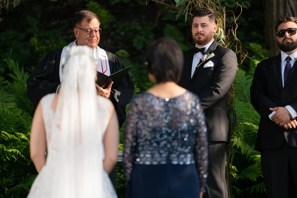 Groom seeing his stunning Bride for the first time while walking down the aisle