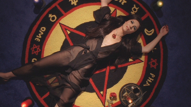 Scorpio:     The Love Witch  (2016)    directed by Anna Biller   Hello fellow Scorpios, as our season looms, I always tend to feel restless yet powerful. We know that we possess confidence and the aptitude to succeed in a multitude of areas, but sometimes we tend to misguide our cosmic gifts. Allow  The Love Witch  to inspire you to channel your abundance of energy. A film that is as subversive as it is aesthetically flawless, Anna Biller's singular vision allows  The Love Witch  to be an atmospheric delight. Biller herself was responsible for the lion's share of the production, tackling the writing, directing, editing, production design, and costume design by herself. While that is certainly a behemoth project to take on, the results are stunning, and as a Scorpio, I can relate to wanting to handle every detail of a creative project to ensure my vision is impeccably executed. Scorpios are known for their all encompassing obsessions, and Elaine (Samantha Robinson), the star of the film, can undoubtedly relate to that. A breathtakingly beautiful young witch, Elaine is determined to use her feminine wiles and occult knowledge to seduce a man. Unfortunately for her, the mortal men she attracts are too vulnerable to Elaine's magic, and her spells render them needy and broken. Scorpios, you will feel at home watching  The Love Witch , a film that is both sumptuous and campy, made by and about women who follow their passions.