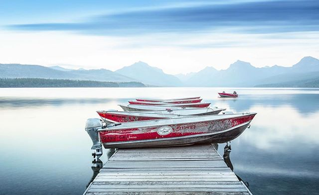 """Gunsight"" Glacier National Park, MT A 5 minute exposure blurs the quickly moving clouds over Glacier National Park's, Lake McDonald. I loved the way the bright red boats stood out against the otherwise monotone scene. Thanks for looking!"