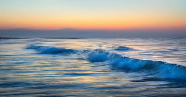 """Watercolor""  Charleston, SC  Using a 1/2 sec exposure, I panned the camera along with the waves to create this abstract rendition of Atlantic coast at sunrise. I loved the way all of the the color of the sunrise, mixed with panning motion of the camera created strips of different colors in the water.  Thanks for looking!"