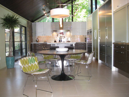 Modern dining area and kitchen with stainless appliances