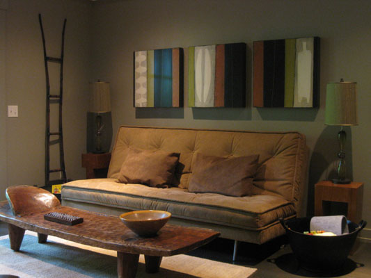 Low light modern living room with brown sofa