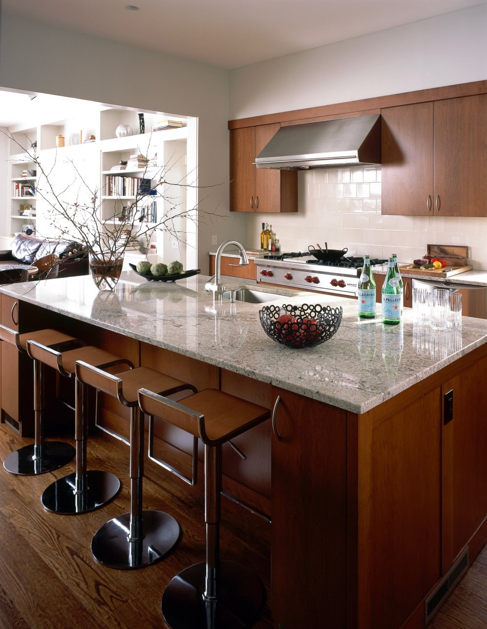Modern style kitchen with kitchen island and four brown chairs