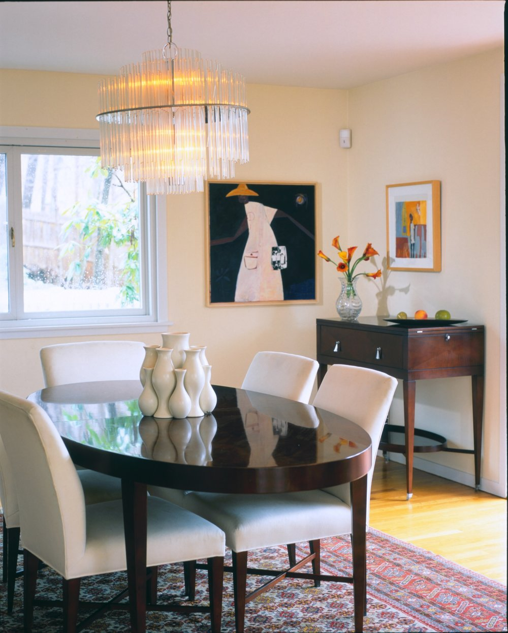 Modern dining room interior with four white chairs