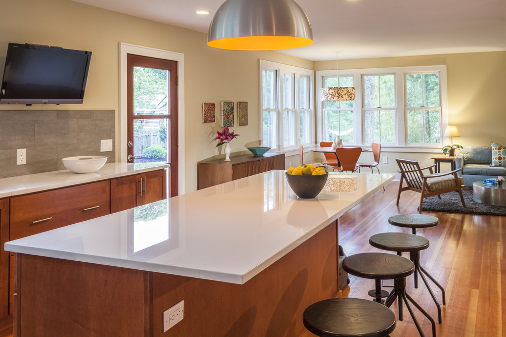 Modern, bright kitchen interior with chairs and kitchen island