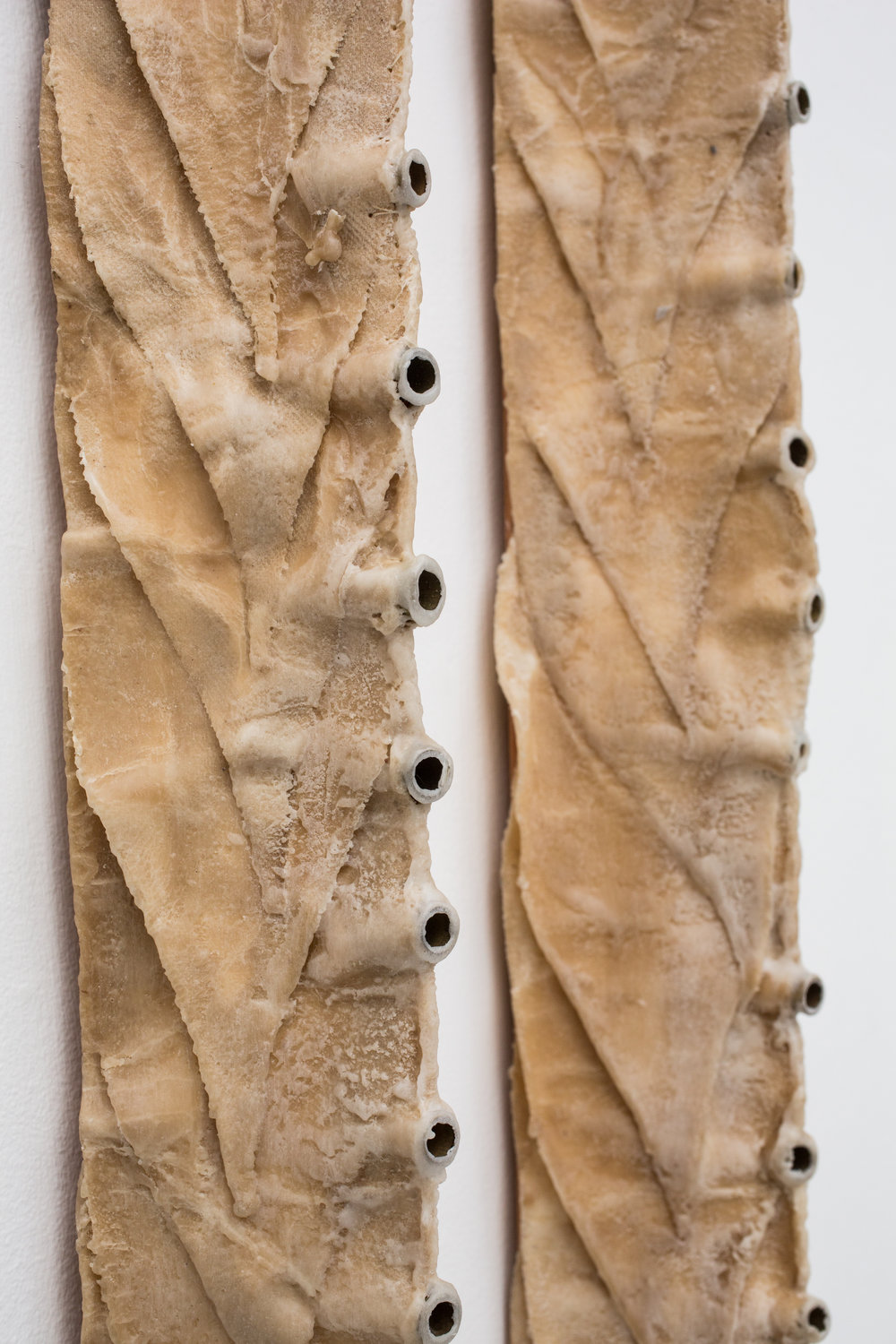 "Demeter Does the Math (and Cries), 2000, (detail), Waxed cloth, shell casings, thread, wood, 80"" x 4"" x 3.5"" (13 units)"