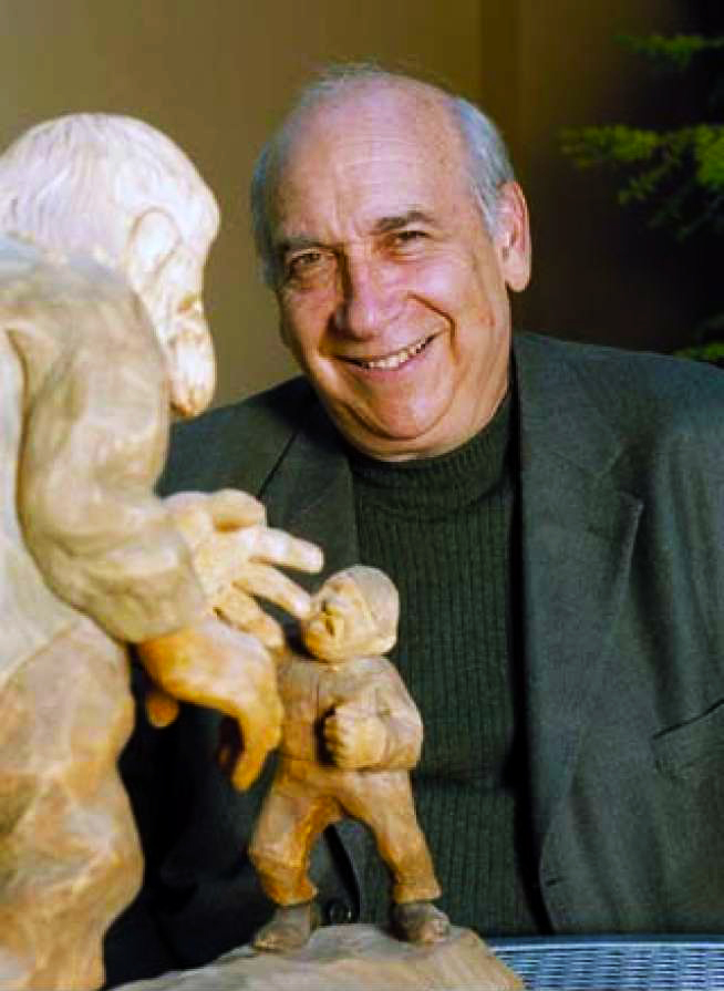 "Professor Alan Dundes with a wooden Norwegian statue of a tale called ""Squeezing the Stone"" or a contest to squeeze water from a stone. Caption and photo adapted from the SF Chronicle's tribute following his death."
