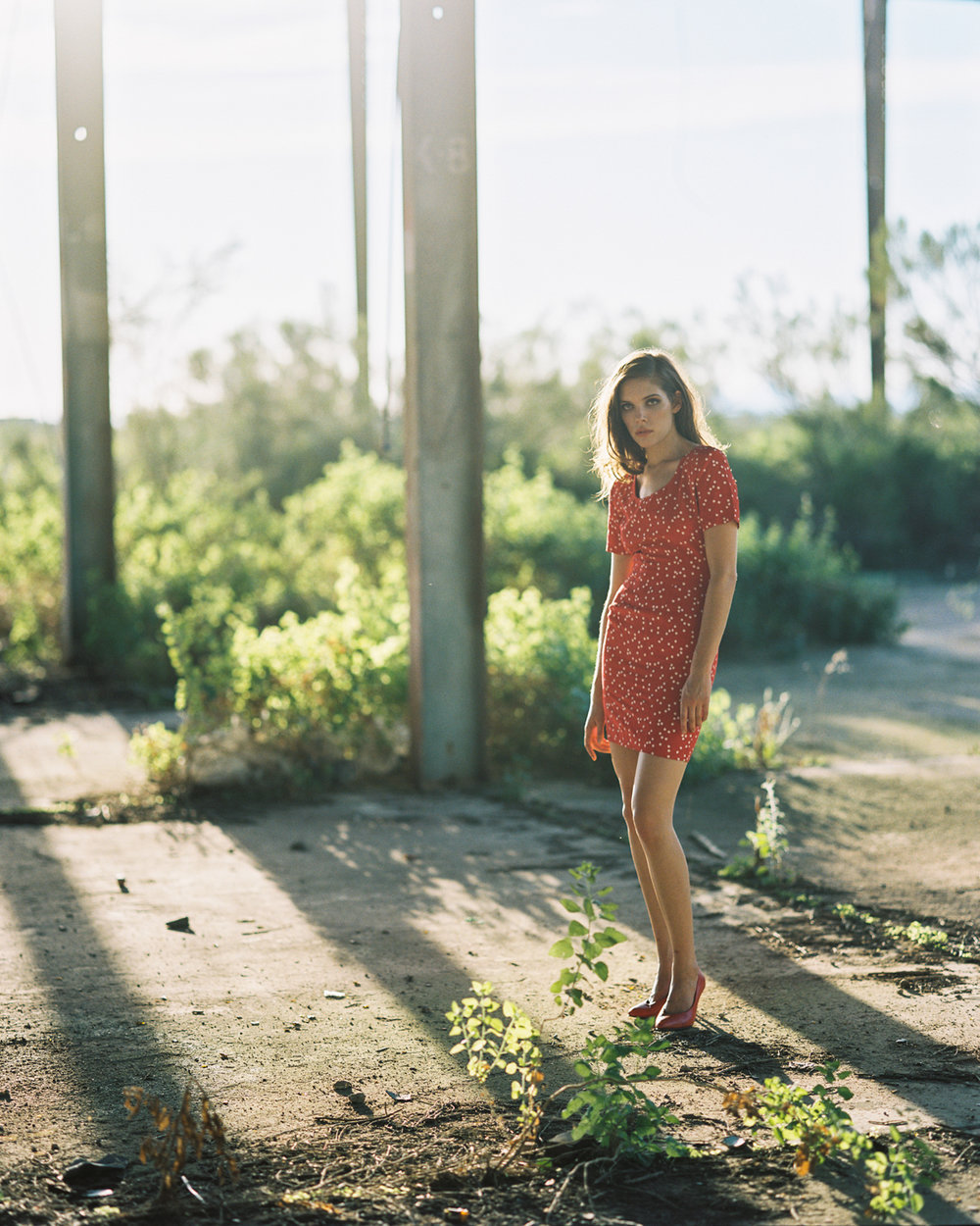 10_Jennifer_Arizona_Pentax_67_kodak_Portra_400_wearhouse_Red_dress_Portrait_Copyright_Taylor_Noel_Photography.jpg