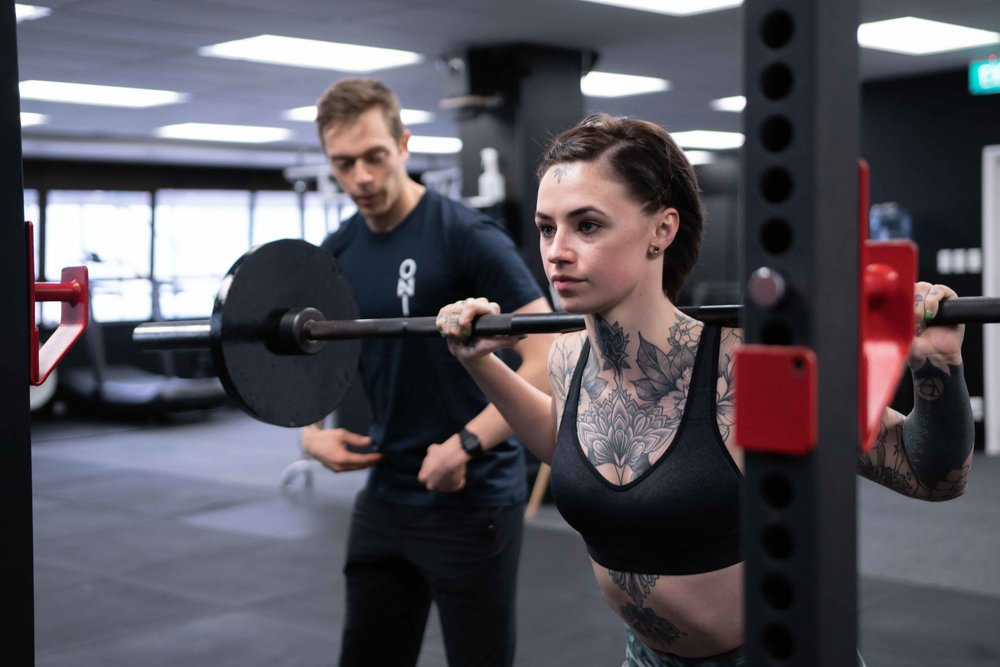 Ben Means helping personal training client.jpg