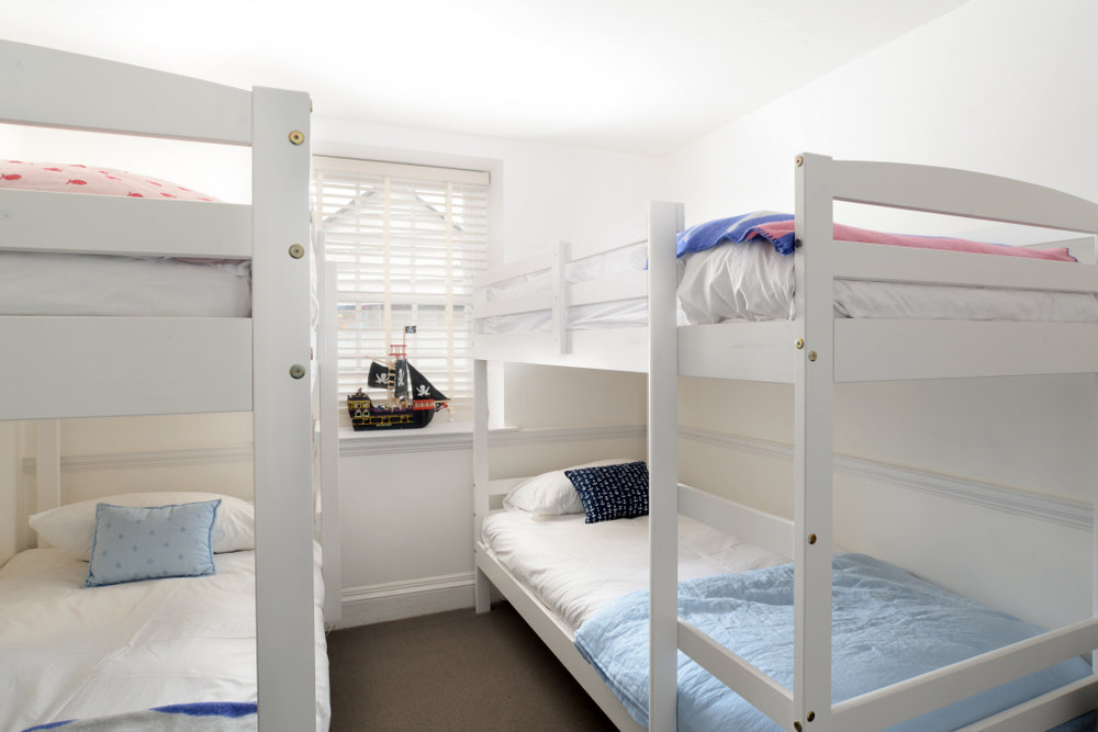 - The second room - The Ships Cabin - has a two bunk bed arrangement - providing sleeping for 4 children and has a small selection of kids books. This room overlooks the courtyard at the back of the house.
