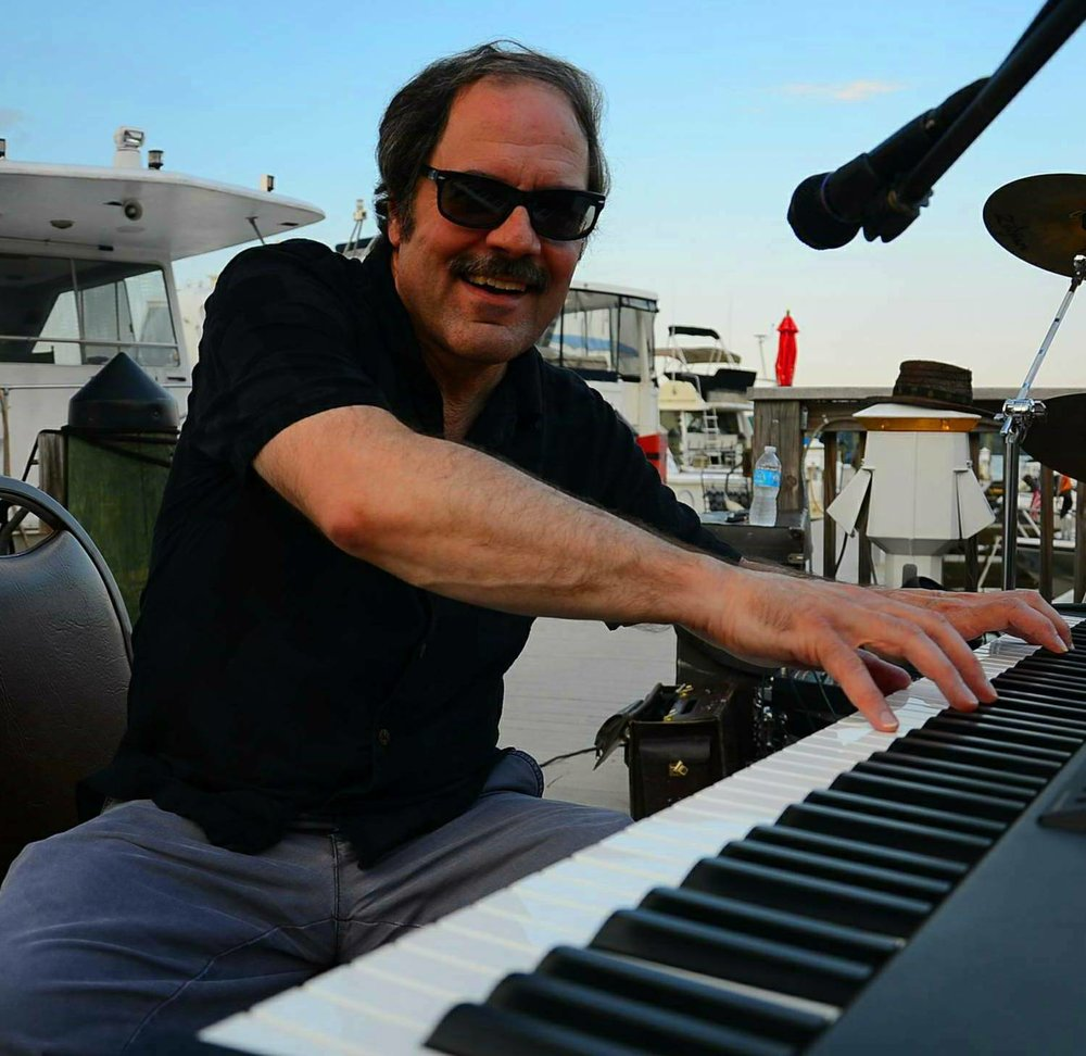 Mike Skaltsounis    Keyboards and vocals   Plays as sophisticated as a five course gourmet dinner the chef has prepared on the Lido deck at sunset with an absolutely fantastic bottle of wine!