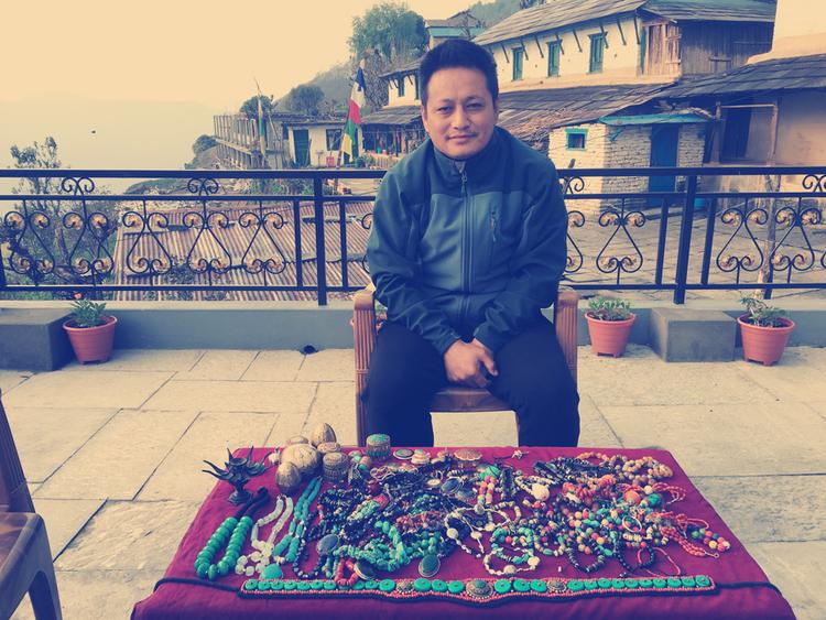 Tibetan Refugee and his wares