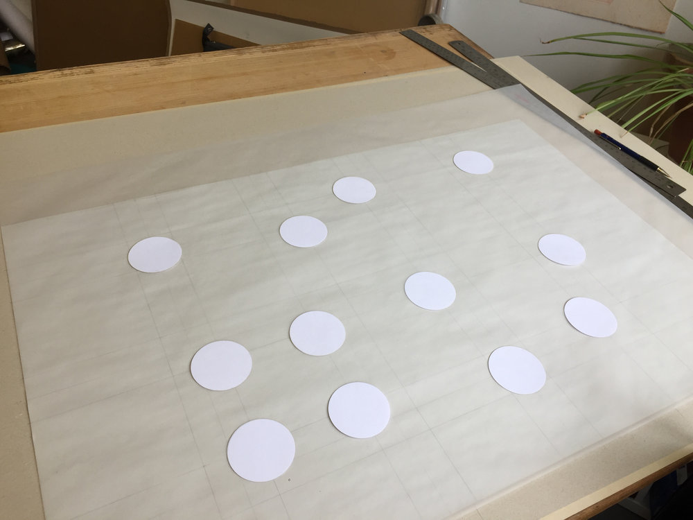 Laser cut dots placed by hand on a hand made grid. Varying levels of precision. Ready to be exposed onto the screen. Pattern scaled up by 10.