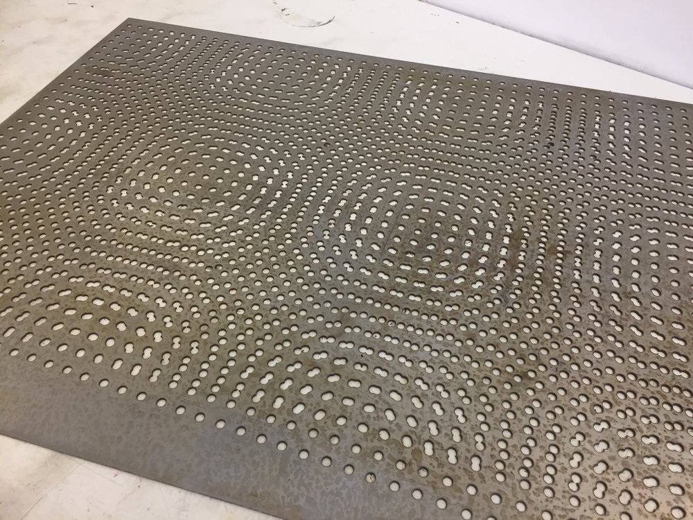 The water jet cut steel plate, before filing, polishing and sanding. The image originates from an earlier screen print.