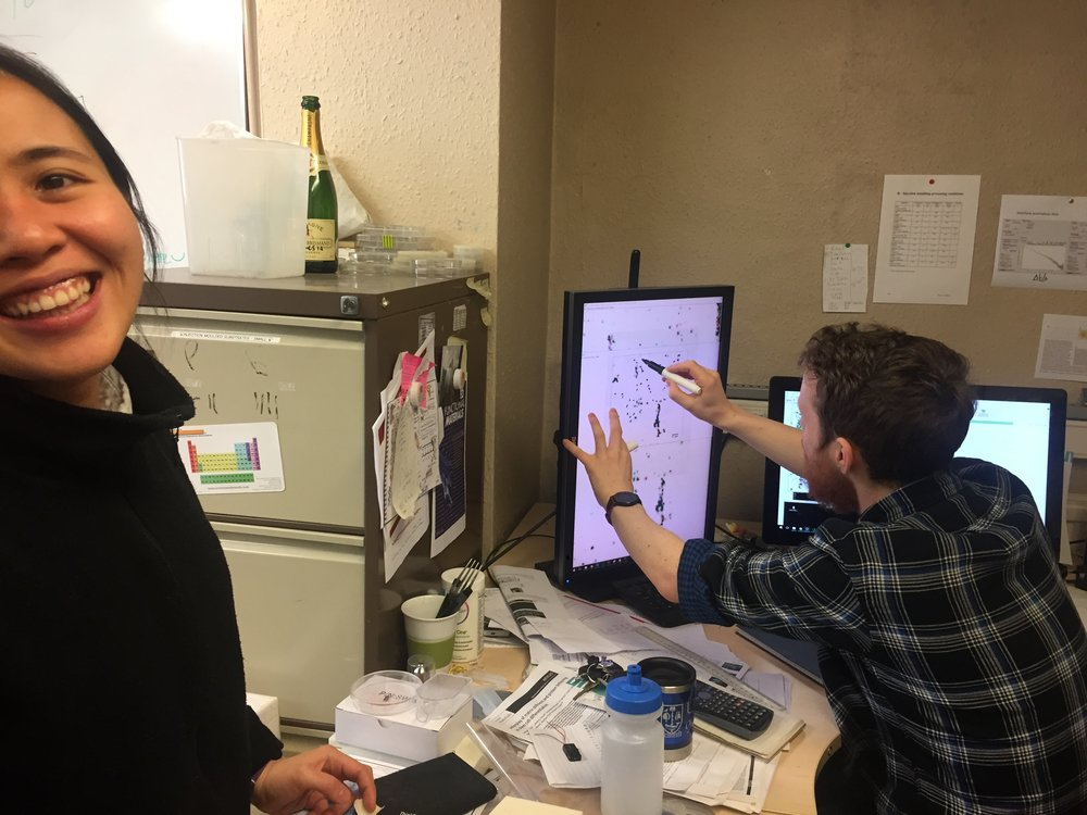 Cell biologist Marie Cutiongco and bioengineer Paul Reynolds in the office.