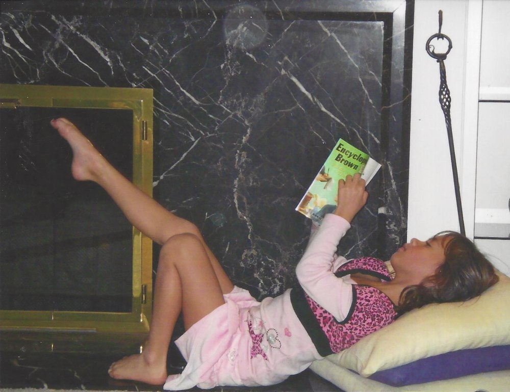 Anna reading at G and Gs house.jpg