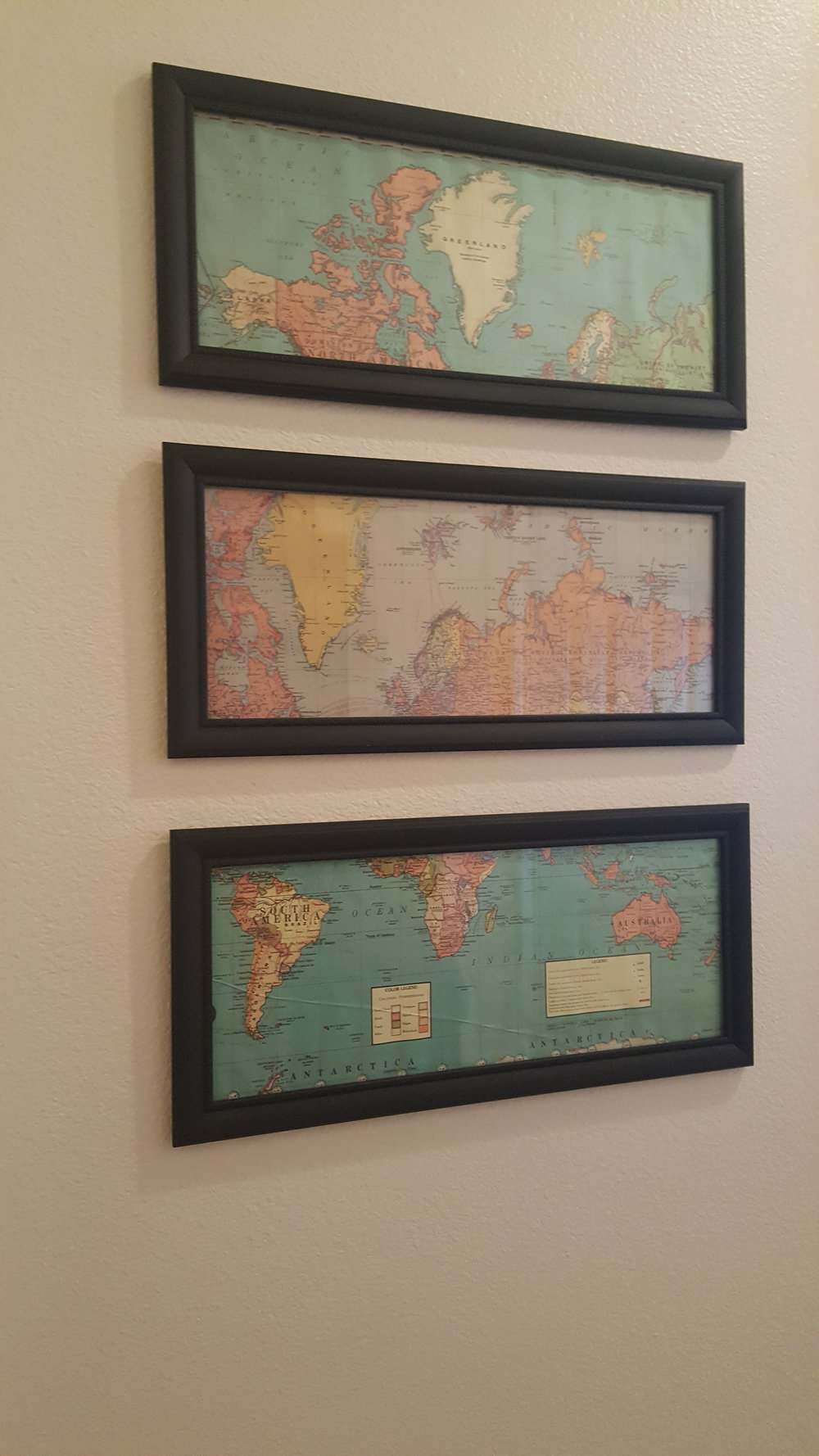 I absolutely love how these turned out! Old maps and mat black frames. perfect.