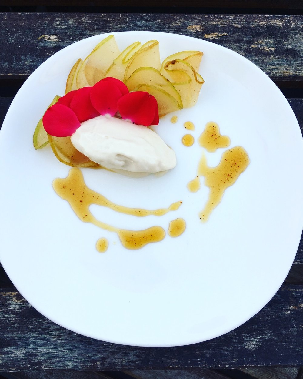 Homemade coconut vanilla ice cream with marinated pears