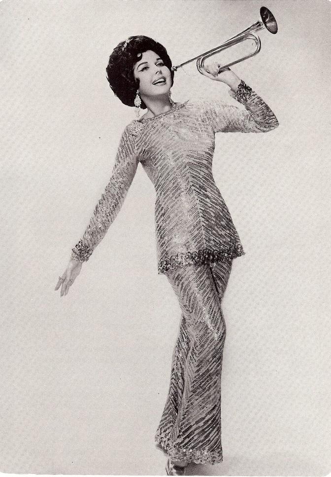 Ann Miller as 'Mame'