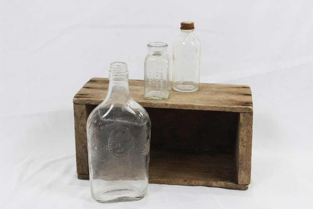 Clear Glass Bottles - Scavenged Vintage Rentals