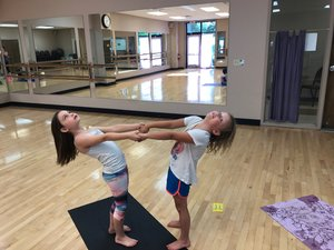 Two Sprouting Yogis Doing Partner Yoga Poses