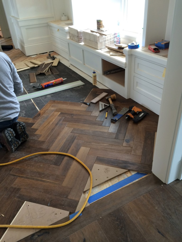 Herringbone flooring in oval office.