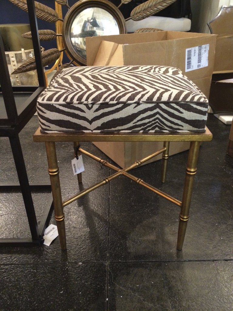 Cutest little stool...I may recover later, but I love the gold legs.
