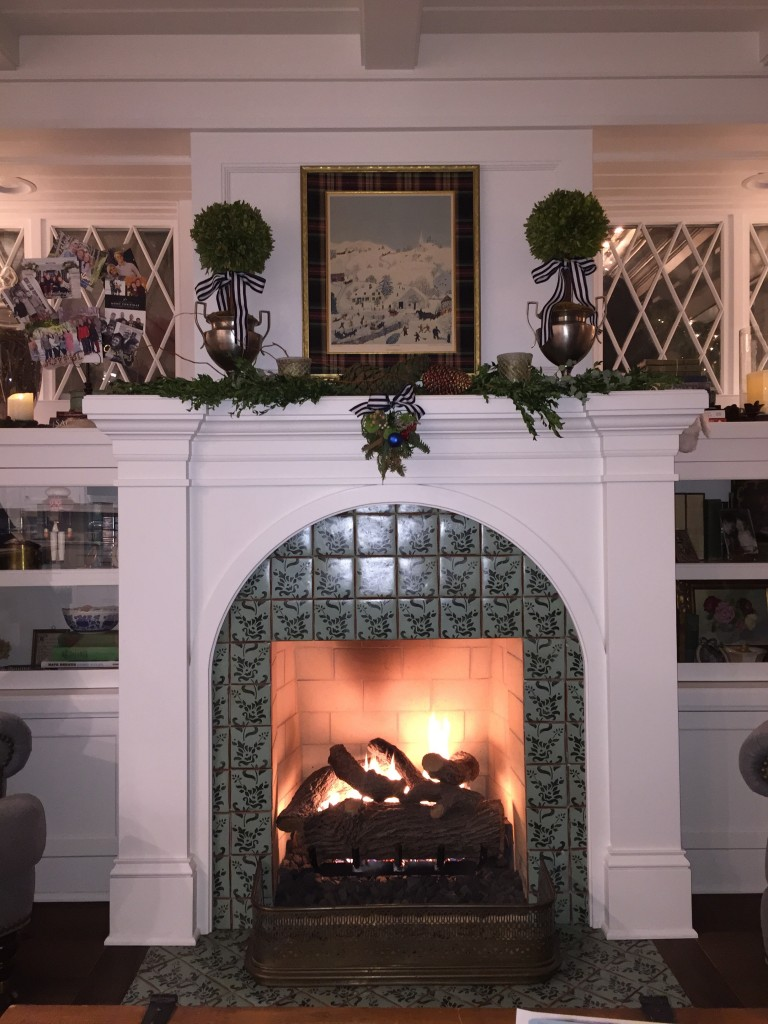 Nook mantel with vintage Christmas painting.
