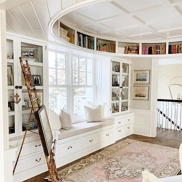 This picture was taken standing in the door to the master...Not sure if anybody really wanted to know that, but now you do! 😉 Rug, bench seat and pillows @thesittingroommn #ovaloffice #circularbookshelf #circularbookcase
