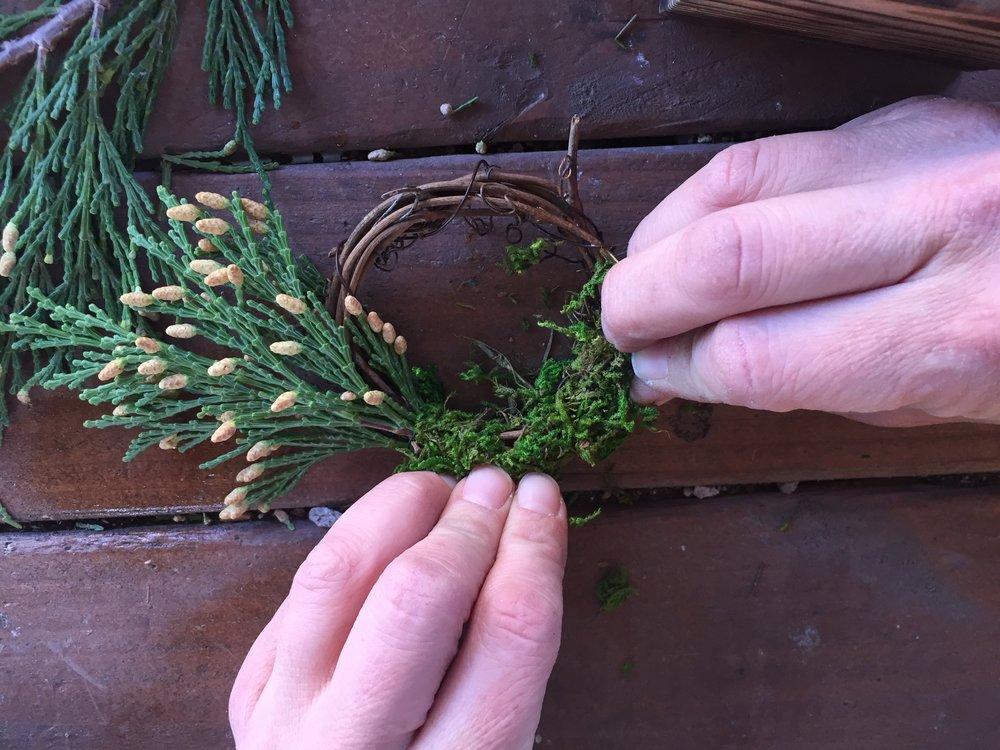 Step 4: Glue moss to wreath