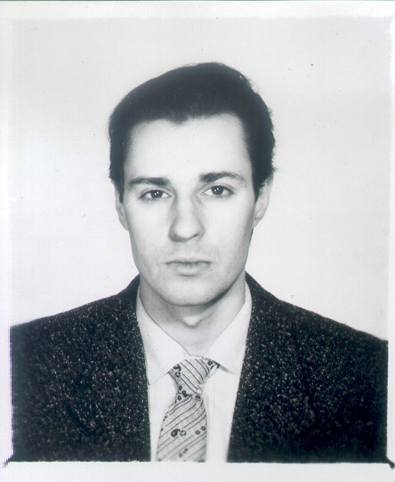 """A Russian passport picture. It says """"Sashenka"""" on it, so that's a clue."""