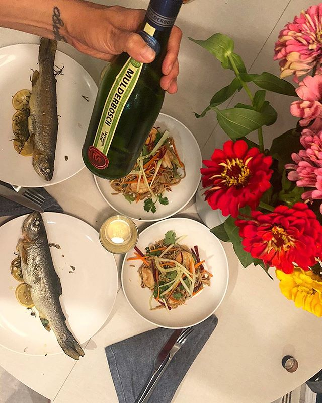 Rainbow Trout, Spicy Soba Noodle Salad with Thai-Style Peanut Dressing- Brooklyn, NY . . Dinner party action with the homie @crystalleester Brought some delicious wine back from South Africa on my last work trip as well as this killer red curry that was used in the spicy soba recipe. These rainbow trout were caught in a NJ river earlier in the year and were tender, light and needed nothing other than lemon, OO, S&P, rosemary and thyme. Baked them at 400 degrees for 10 min after seasoning. I had so much soba in my food coffers, so spicy soba noodle with shrimp it is! Shrimp and fish, what!? Who cares, do whatchoo want! Love having buds over for dinner. Lot's of laughs, catch-up's and good times, thanks Crystal for creating this lovely meal with me. Recipe for the spicy soba can be found at the @foodandwine website, search Spicy Soba Noodle Salad with Thai-Style Peanut Dressing I highly recommend it… . . . . . #give0forks #givezeroforks #masterchef #soba #rainbowtrout #wildcaught #shrimp #brooklynfoodie #fish #foodporn #anolon #kitchencreativity #feedyourfriends #cooking #misenmade #misen #nycgrow #farmersmarket #instayum #instadelicious #wine #mulderbosch #foodandwine #eatfresh #eathealthy #fitfoodie #foodies #dinnerparty #instafood