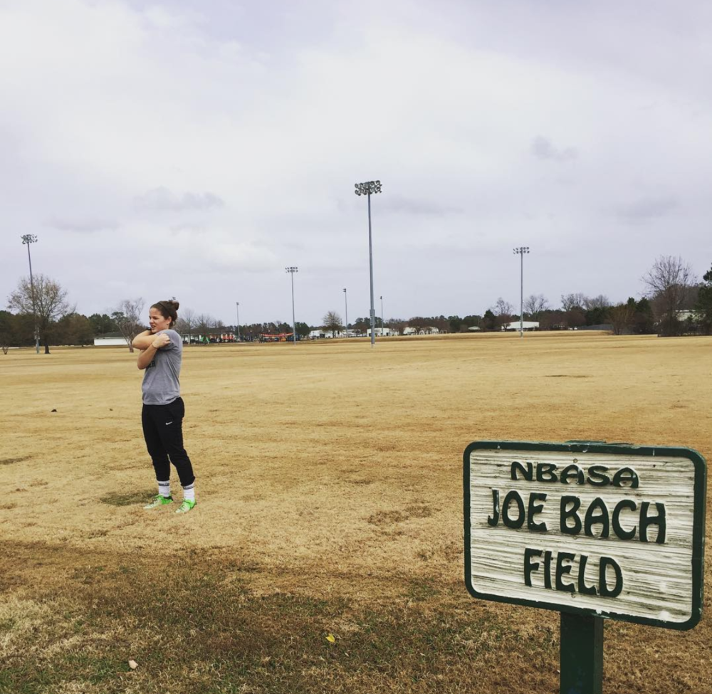 """For me, I had to revisit some places to really """"see"""" myself again. Here, I am kicking at my childhood pitch, where I fell so in love with football that I would never be able to let it go."""